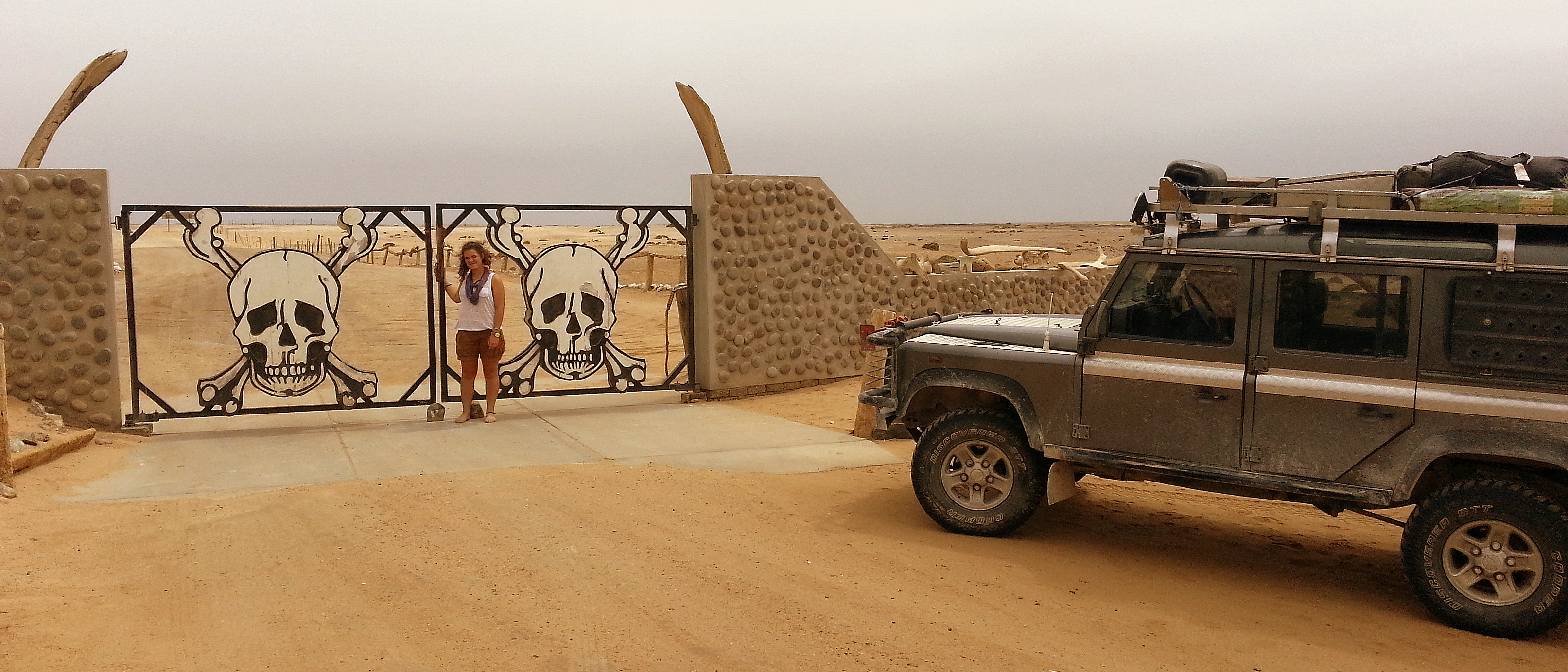 Happy girl at Ugab river gate, the Southern entry point into the Skeleton Coast National Park.